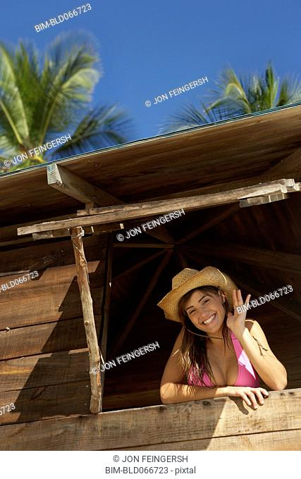 Woman in lifeguard tower at beach