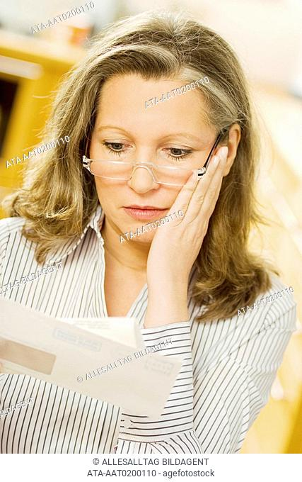 Woman reading official letter