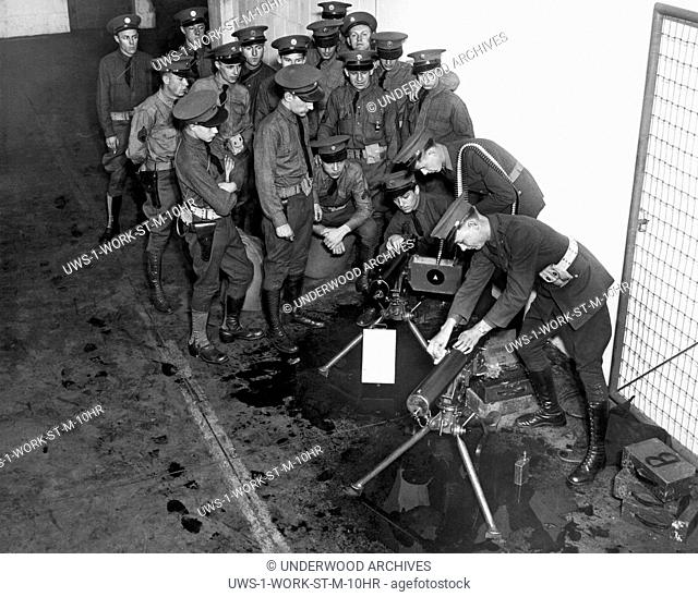 MInneapolis, MInnesota: 1934 National Guardsmen prepare for action against the truckers strike. Here they are getting their armory machines guns in order