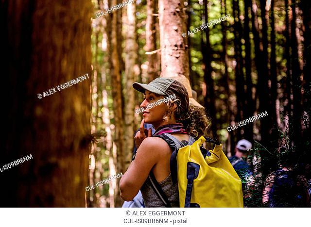 Friends hiking in forest, Johnstone Strait, Telegraph Cove, Canada