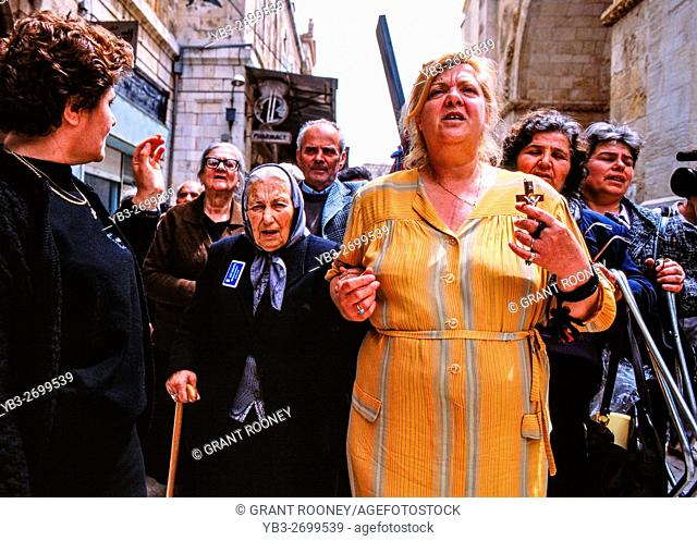 An Easter Procession Of Devout Christians Along The Via Dolorosa, Old City of Jerusalem, Israel
