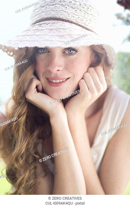 Close up portrait of beautiful young woman in garden