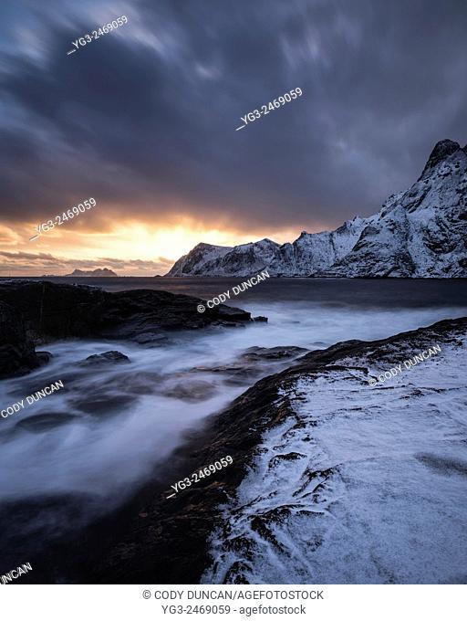 Winter sunser over snow covered coast at Š, Moskenesøy, Lofoten Islands, Norway