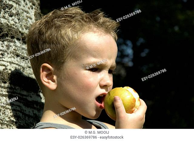 Kid going to take a bite off an apple