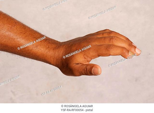 Male hand, vertical, Belém, Pará, Brazil