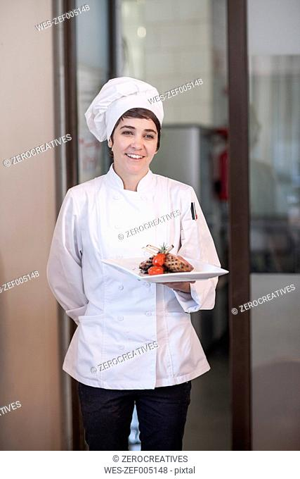 Chef serving main dish