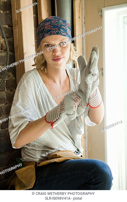 Woman wearing protective gloves