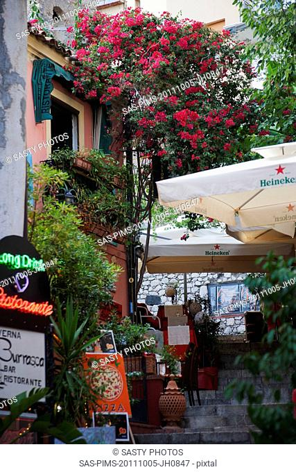 Sidewalk cafe in a street, Taormina, Province of Messina, Sicily, Italy