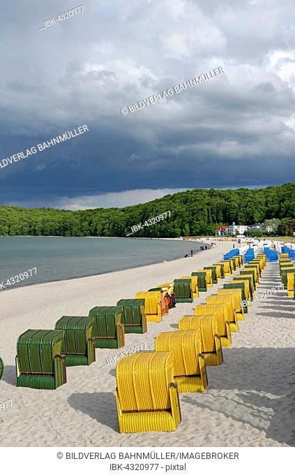 Colourful beach chairs on the sandy beach of the Baltic Sea, seaside resort of Binz, Rügen, Mecklenburg-Western Pomerania, Germany