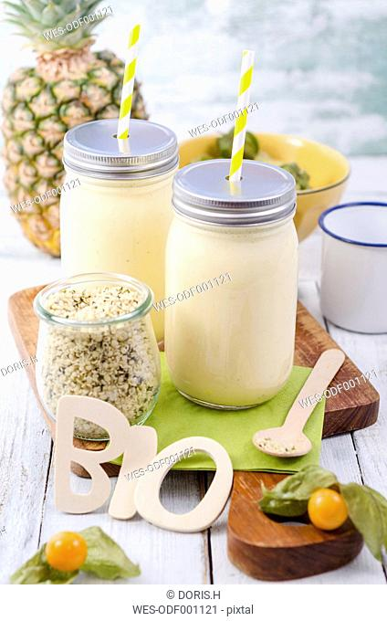 Pineapple smoothies to go with physalis and hempseeds