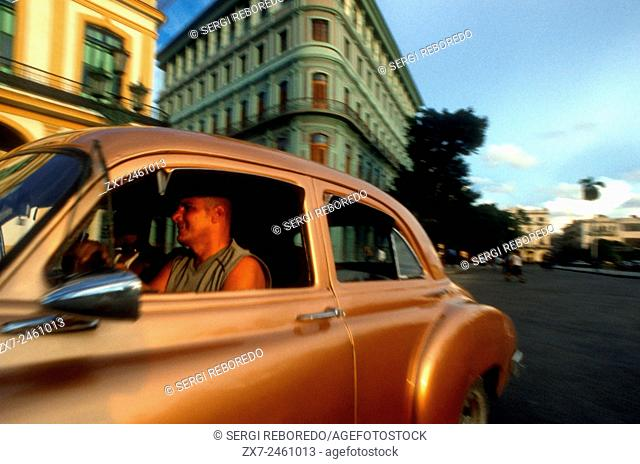 Old car 1950s Chevrolet passing the Saratoga Hotel, Paseo de Marti, Old Havana, Cuba