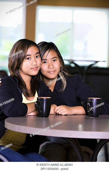 Two girls sitting together