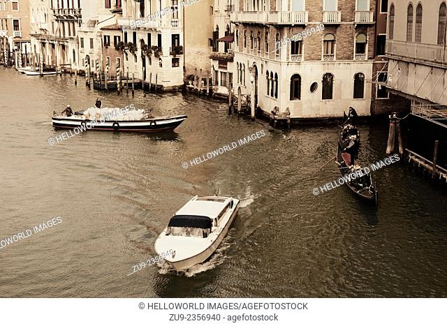Gondolas, motor boat and delivery boat on the grand canal, Venice, Veneto, Italy, Eurooe