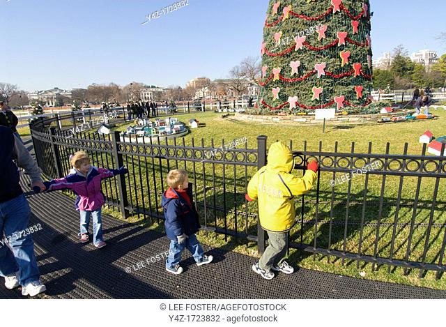 Washington DC, USA, children at National Christmas Tree outside the White House, with gingerbread Victorian village