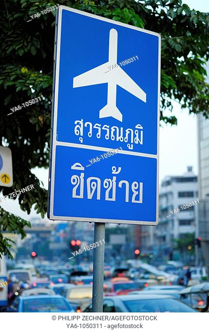 Airport sign in front of a traffic jam in Bangkok, Thailand