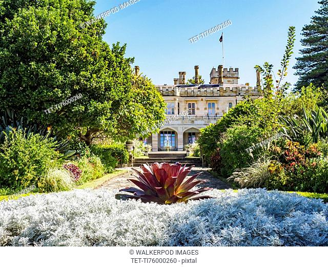 Australia, New South Wales, Sydney, Ornamental garden with building in background