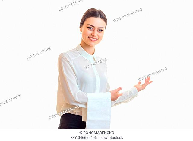 Cheerful waitress smiles on camera in uniform isolated on white background