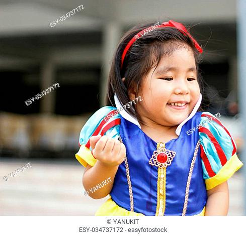 potrait princess dress with cute asian girl show hand for hold something
