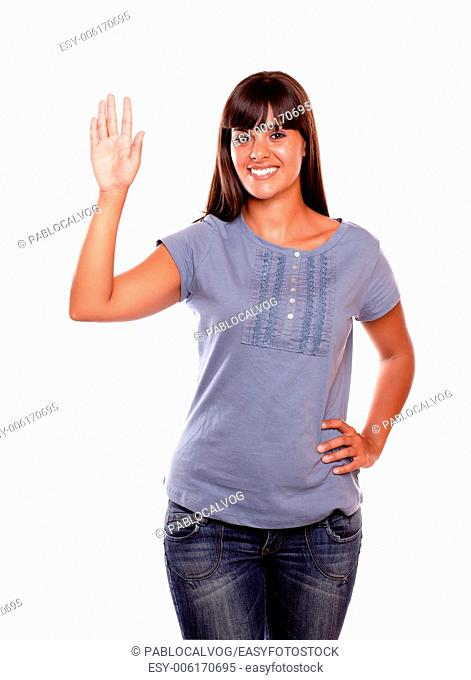 Friendly young woman greeting on blue shirt against white background