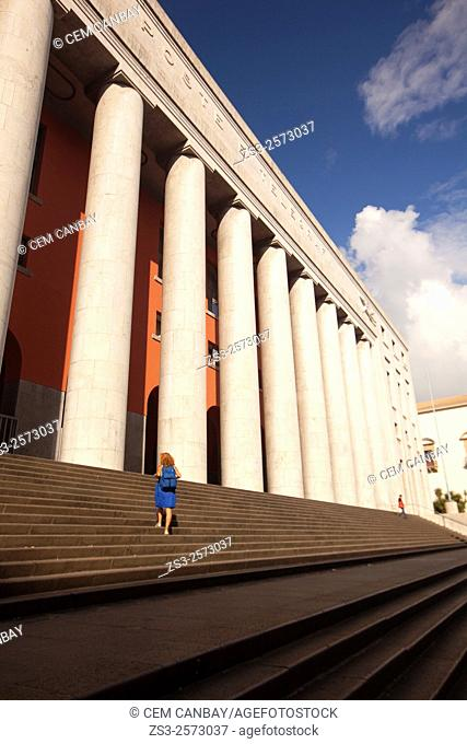 Woman at the stairs of the Post and Telegraph Building in city center, Palermo, Sicly, Italy, Europe