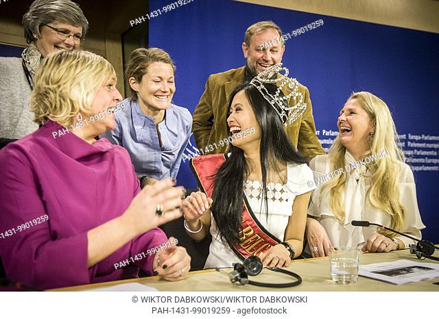 Miss Belgium 2018 Angeline Flor Pua with Belgian members of the parliament (MEPs) during a visit to the European Parliament headquarters in Brussels