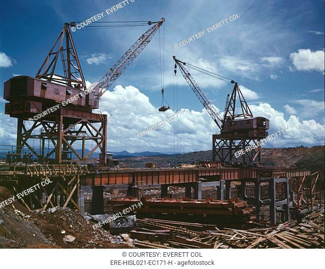 Massive cranes on a steel superstructure during the construction of Douglas Dam, a Tennessee Valley Authority public works project. June 1942