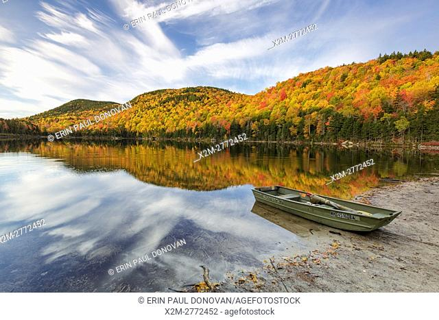 Reflection of autumn foliage in Upper Hall Pond in Sandwich, New Hampshire USA during the autumn months