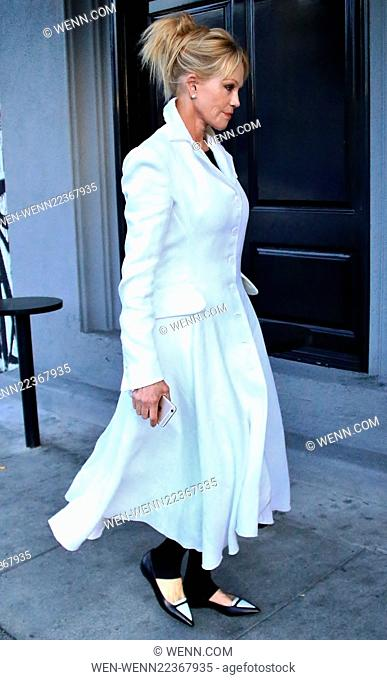 Melanie Griffith wearing a full length white overcoat arrives at Craig's in West Hollywood for dinner Featuring: Melanie Griffith Where: Los Angeles, California