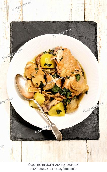 traditional irish farmhouse chicken stew with root vegetable and parsley