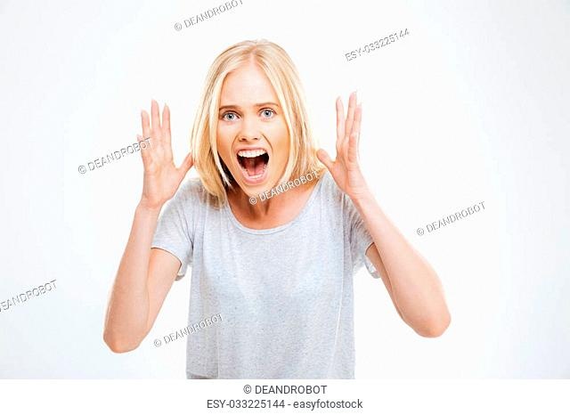 Screaming young beautiful girl looking at the camera isolated on the white background