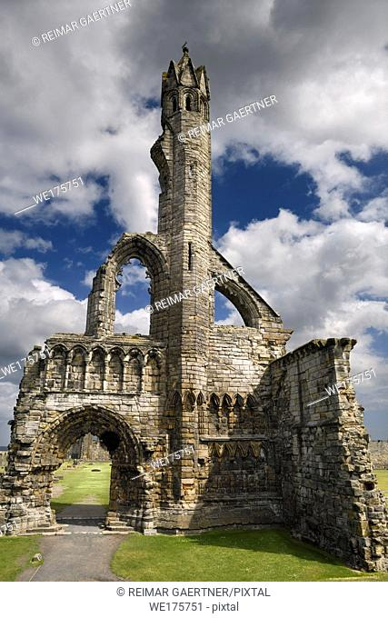 Sun on stone ruins of the 14th Century West Entrance and tower of St Andrews Cathedral with clouds St Andrews Fife Scotland UK