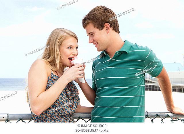 Teenage couple with snow cone