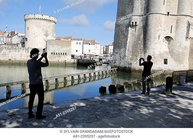 France, Poitou-Charente region, Charente maritime departement (17), Historic City of La Rochelle, taking pictures by rear the Chaine tower (Tour de la Chaine)