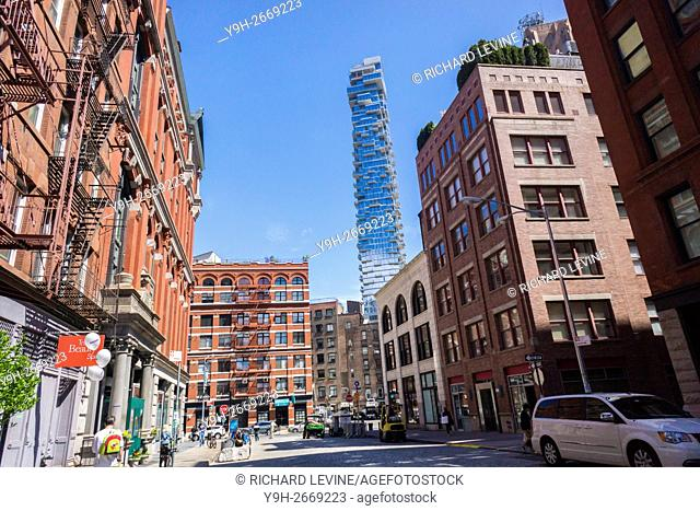 The condo skyscraper at 56 Leonard Street looms over older buildings in Tribeca in New York. Designed by Herzog & de Meuron the condo is 820 feet high with 145...