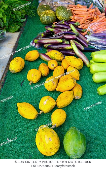Images from a farmers market in Hawaii showing tropical fruits or vegetables in simple photos with vibrant colors