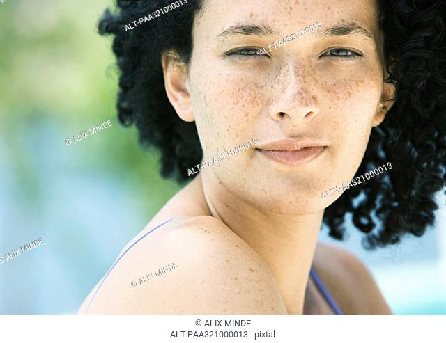Young woman with freckles, portrait