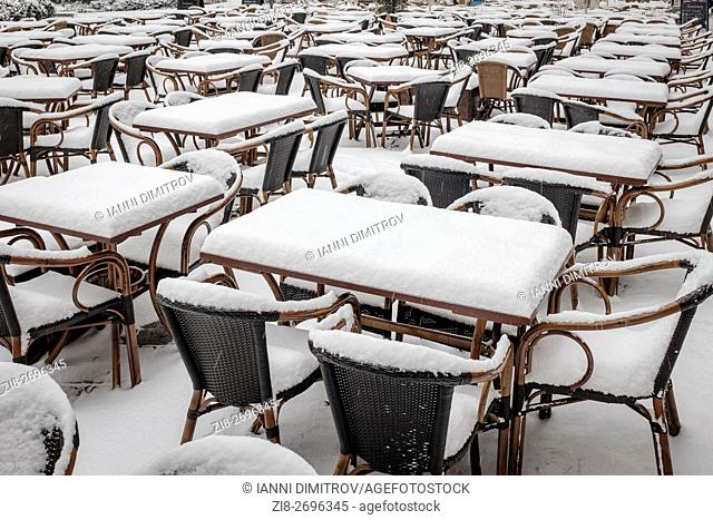 Germany,Berlin,Hackescher Markt-emty restaurant tables covered in snow