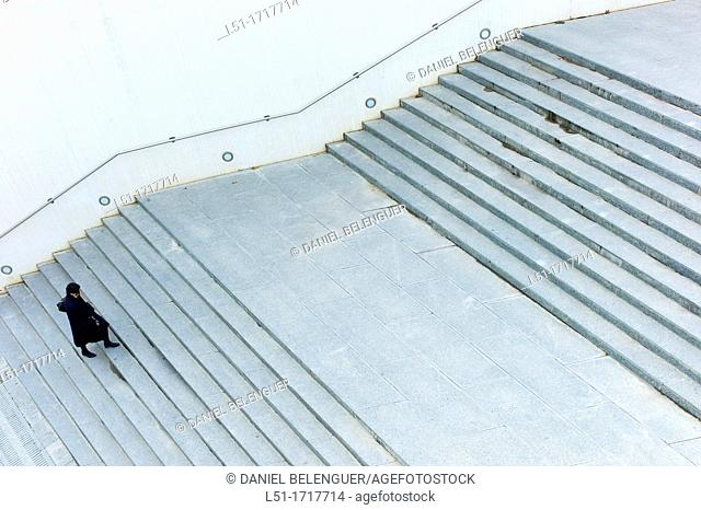 woman walking up stairs, Ciudad e las Artes y las Ciencias, Valencia, Spain