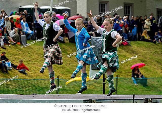 Girls dancing in kilts at a folk dance competition, Ceres Highland Games, Ceres, Scotland, United Kingdom