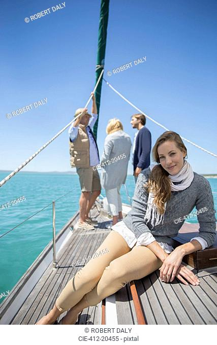 Girl sitting on deck of sailboat