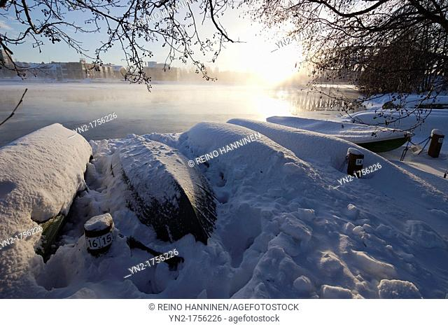 Upturned and beached rowboats stored at Winter  Location River Oulujoki Oulu Finland Scandinavia Europe