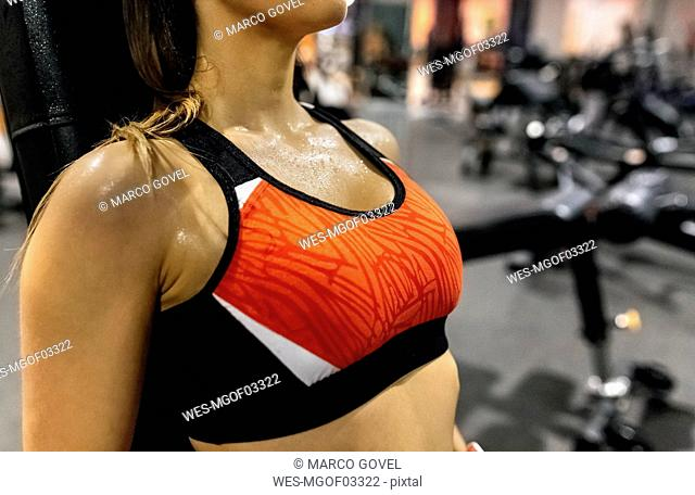 Close-up of woman sweating in gym