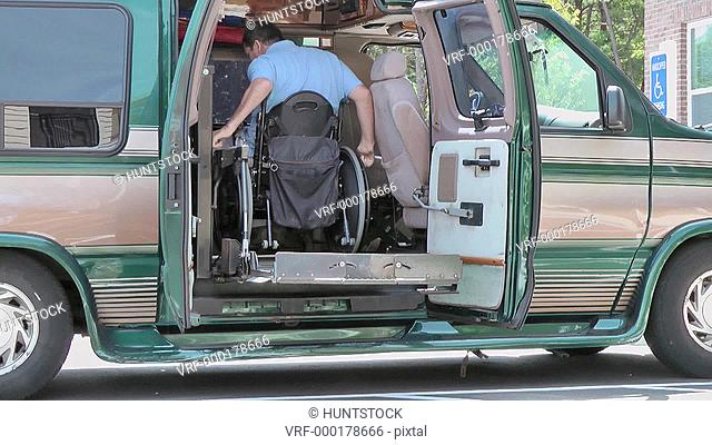 Man with spinal cord injury boarding accessible van