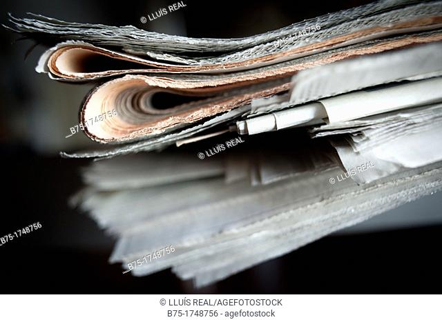 Pile of folded newspapers, press
