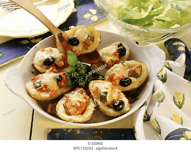 Potatoes with Provencal vegetable filling, cheese topping