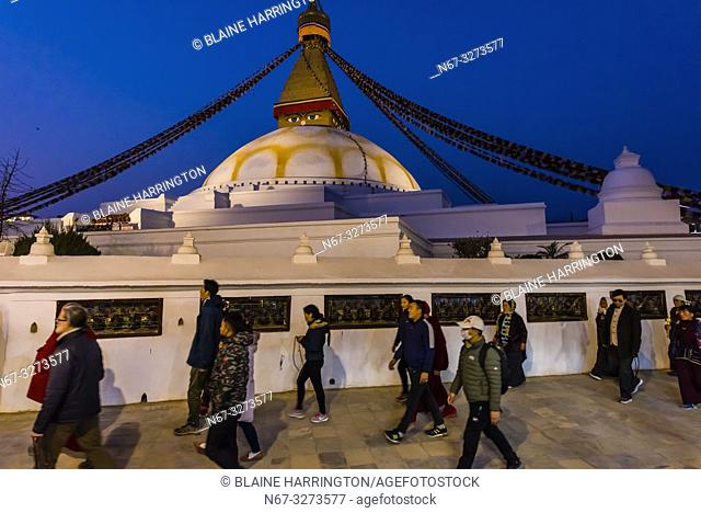 Buddhist pilgrims circumambulate the massive Boudhanath Stupa (the largest stupa in Nepal and the holiest Tibetan Buddhist temple outside Tibet