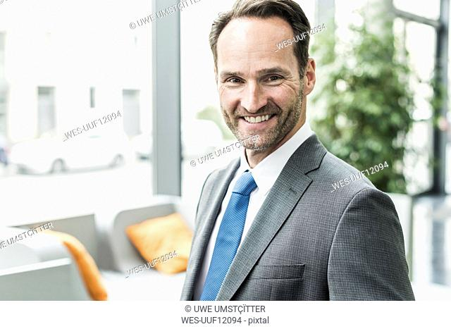 Portrait of smiling businessman