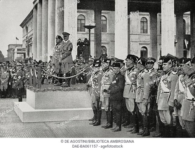 Benito Mussolini, Adolf Hitler and some of the leaders of the Fascist Party and the Nazi Party attend the German armed forces parade in Munich, Germany