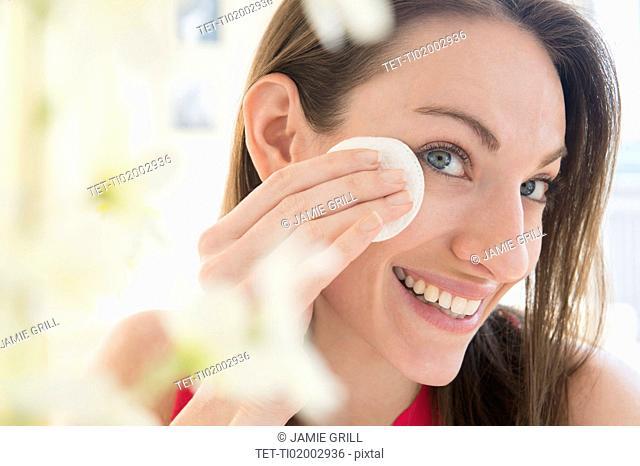 Woman using cotton pad