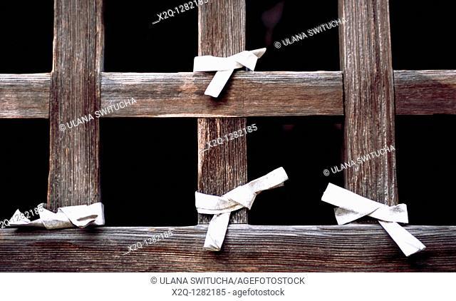 Paper prayers tied to a temple window in Yamadera Yamagata Japan